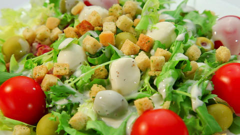 Salad with mozarella cheese - plate with vegetables salad... Stock Video Footage