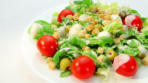 Salad with mozarella cheese and dressing Footage