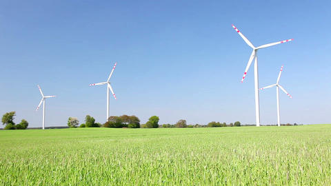 Natural energy - windmills and green grain field Stock Video Footage