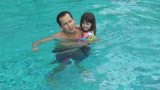 Daughter kisses her father in the pool. They are happy Stock Video Footage