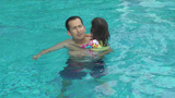 Daughter kisses her father in the pool. They are happy Footage