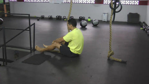 Athlete making leg less rope climb crossfit exercise Stock Video Footage