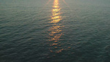 Calm scene of a wavy ocean in motion over a smooth sunshine Stock Video Footage