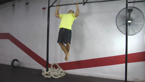 Athlete making strict pull ups crossfit exercise Stock Video Footage