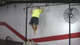 Athlete Making Strict Pull Ups Crossfit Exercise stock footage