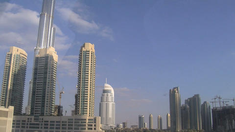 Sun reflextion at the burj khalifa Stock Video Footage