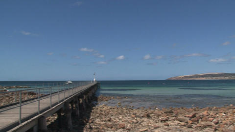 Pan from a bay to a pier at Remarkable Rock Stock Video Footage