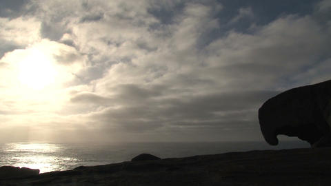 Morning sunshine through the clouds at sea with th Stock Video Footage