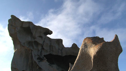 Clouds passing by the Remarkable Rock Stock Video Footage