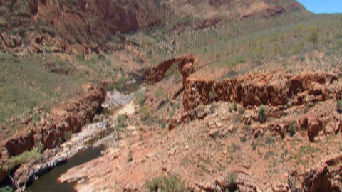 Tilt from a river at the MacDonnell Ranges Footage