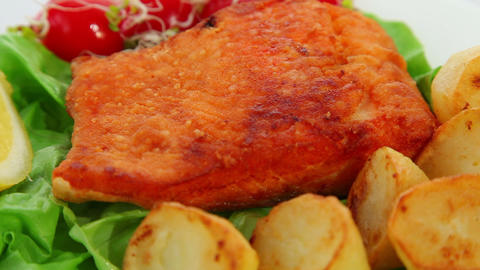 Salmon fried with vegetables and lemon Stock Video Footage