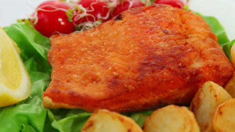 Salmon fried with vegetables and lemon Footage