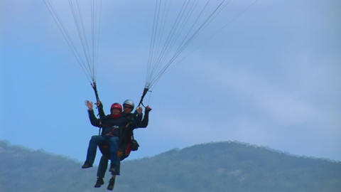 Paraglider Lands stock footage