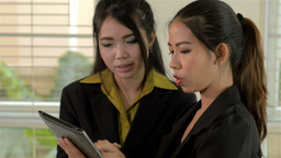 Asian Businesswomen in the Office, Discussing Work on a... Stock Video Footage