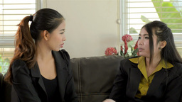 Two Young Asian Businesswomen Chatting Stock Video Footage
