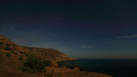 Night landscape, night sky with moving stars over the... Stock Video Footage