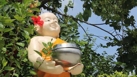 Chubby Buddhist Statue Holding Donation Bowl Stock Video Footage