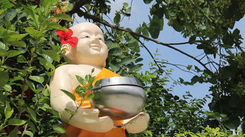 Chubby Buddhist Statue Holding Donation Bowl Footage