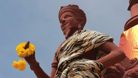 Tiger Print Cloth On Buddhist Statue Stock Video Footage