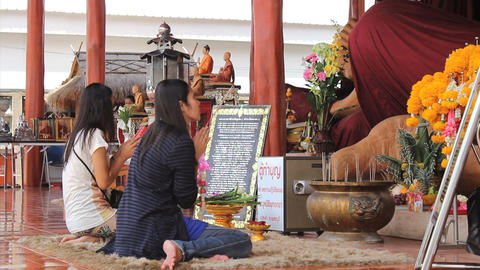 Two Women Pay Respects At Buddhist Temple Footage