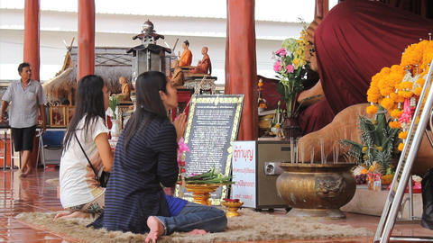 Two Women Pay Respects At Buddhist Temple Stock Video Footage
