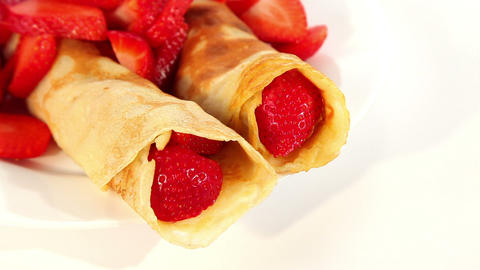 Pancakes with red sweet strawberries, sweet dessert Stock Video Footage