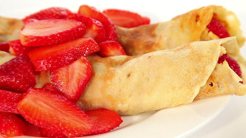 Two pancakes and strawberry on white plate, sweet dessert Stock Video Footage