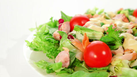 Salad with lettuce, tomato and chicken Footage