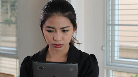 Asian Female Office Worker Reading On Tablet Stock Video Footage