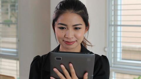 Cute Asian Female Office Working Laughing With Tablet Stock Video Footage