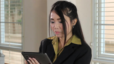 Serious Asian Office Worker Using Tablet Stock Video Footage
