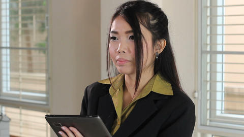 Serious Asian Office Worker Using Tablet Footage