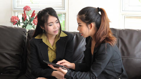Female Asian Office Workers Working On Tablet Stock Video Footage