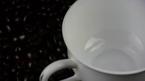 pouring a cup of coffee & coffee beans background,top... Stock Video Footage