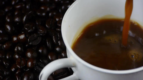 pouring a cup of coffee & coffee beans background,top view Footage