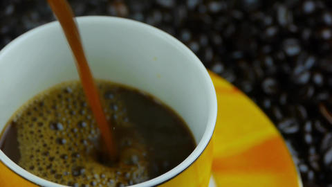 pouring a cup of coffee & milk mixing,coffee beans... Stock Video Footage