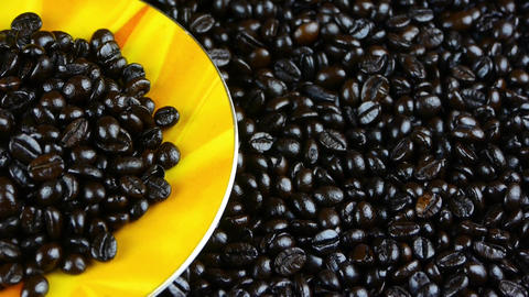 coffee beans in cup saucer close up,top view Footage