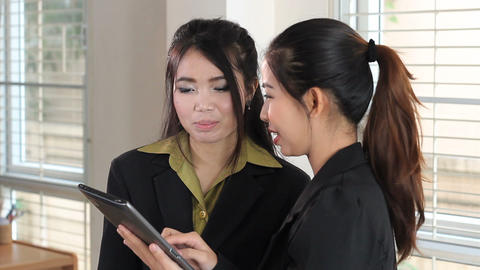 Office Workers Using Tablet For Project Stock Video Footage