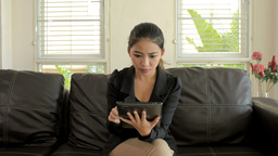 Wide Angle Shot of a Young Asian Woman Reading on Her... Stock Video Footage