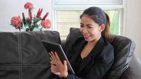 Asian Female Office Worker Talking On Tablet Stock Video Footage
