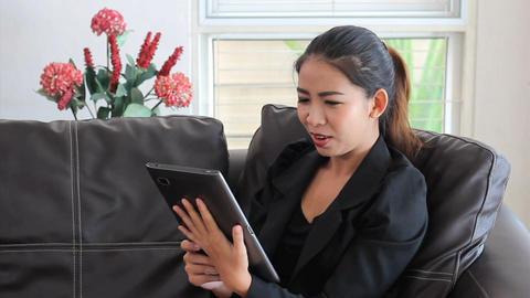 Asian Female Office Worker Talking On Tablet Stock Video Footage