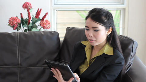 Female Asian Office Worker Using Tablet Footage