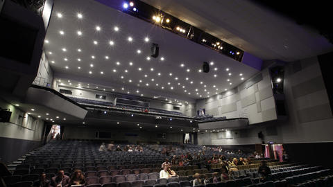 People fill the theatre. Time lapse Stock Video Footage