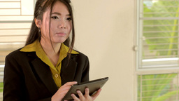 Young Business Woman Using a Tablet Footage