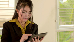 Young Business Woman Using a Tablet Stock Video Footage