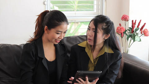 Attractive Asian Office Workers Using Tablet Footage