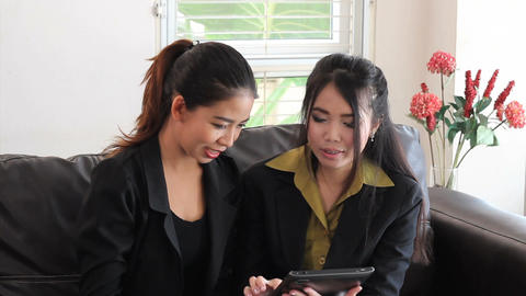 Attractive Asian Office Workers Using Tablet Stock Video Footage