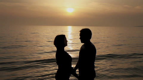 Couple kissing at sunset on the seashore Stock Video Footage