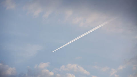 Airplane track with motion in the blue sky ビデオ