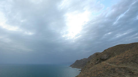 Cloudy Sky Over The Mountains And The Sea. Mountain Meganom, Crimea, Ukraine stock footage